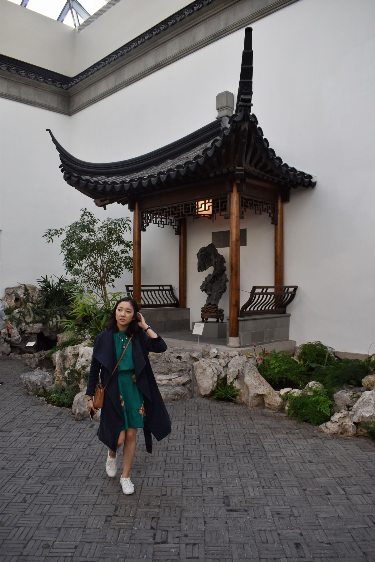 Outfit post by a japanese shrine instalment at the MET museum. Wearing a Club Monaco navy blue duster coat, green floral Effet dress by Aritzia, and women's ace sneakers by Keds.
