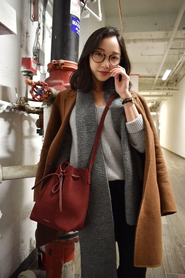 Fun little shoot in the hallways behind a Hale cafe Toronto. Wearing a brown hand made coat by Zara, Mansur Gavriel Mini Bucket Bag in Rococo, Wilfred Wolter sweater, knitted scarf, Mother black denim jeans, Olivia burton mini vintage watch. Sporting a simple korean beauty makeup look.