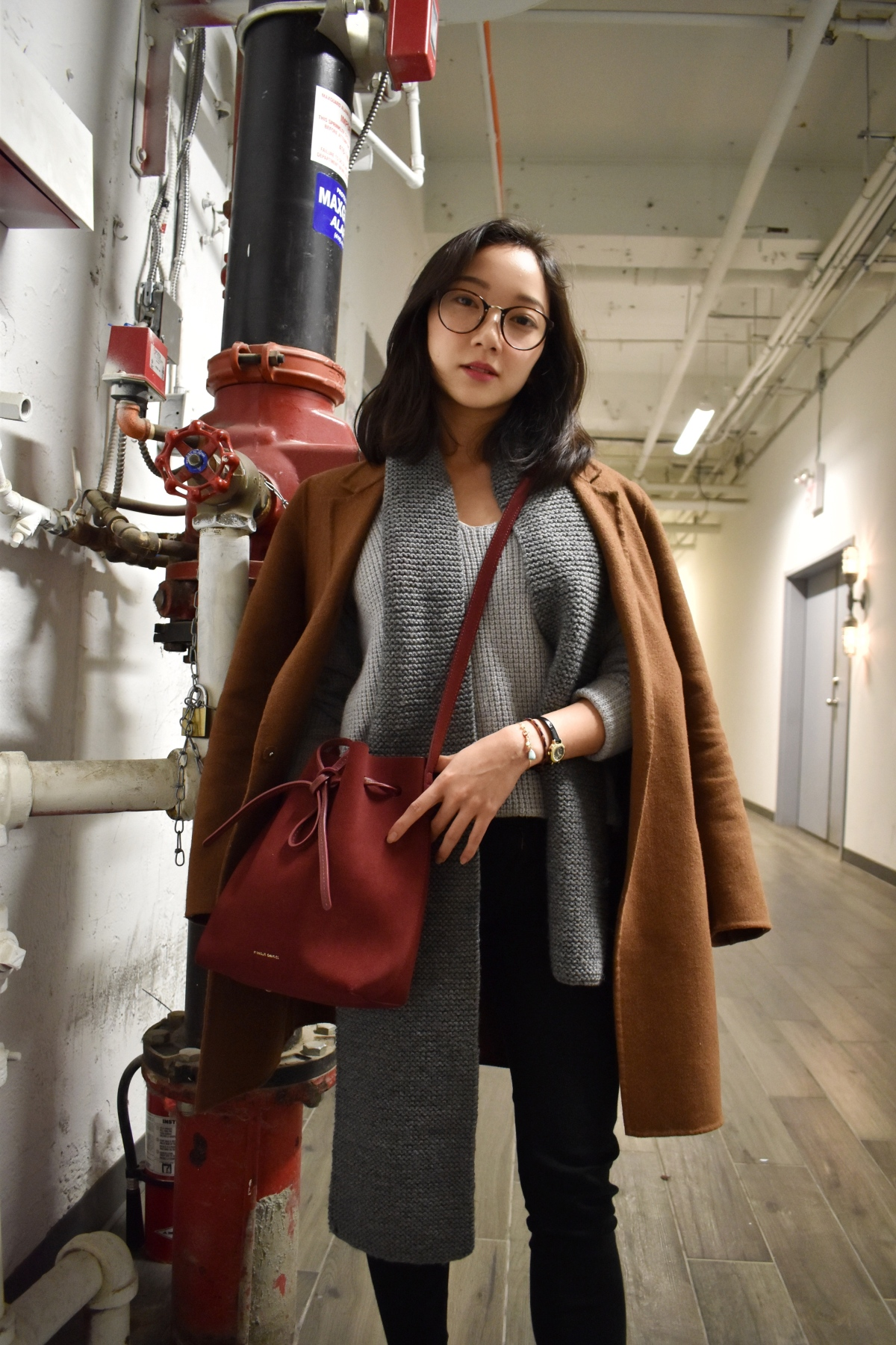 Fun little shoot in the hallways behind a Hale cafe Toronto. Wearing a brown hand made coat by Zara, Mansur Gavriel Mini Bucket Bag in Rococo, Wilfred Wolter sweater, knitted scarf, Mother black denim jeans, Olivia burton mini vintage watch. Korean beauty makeup look.