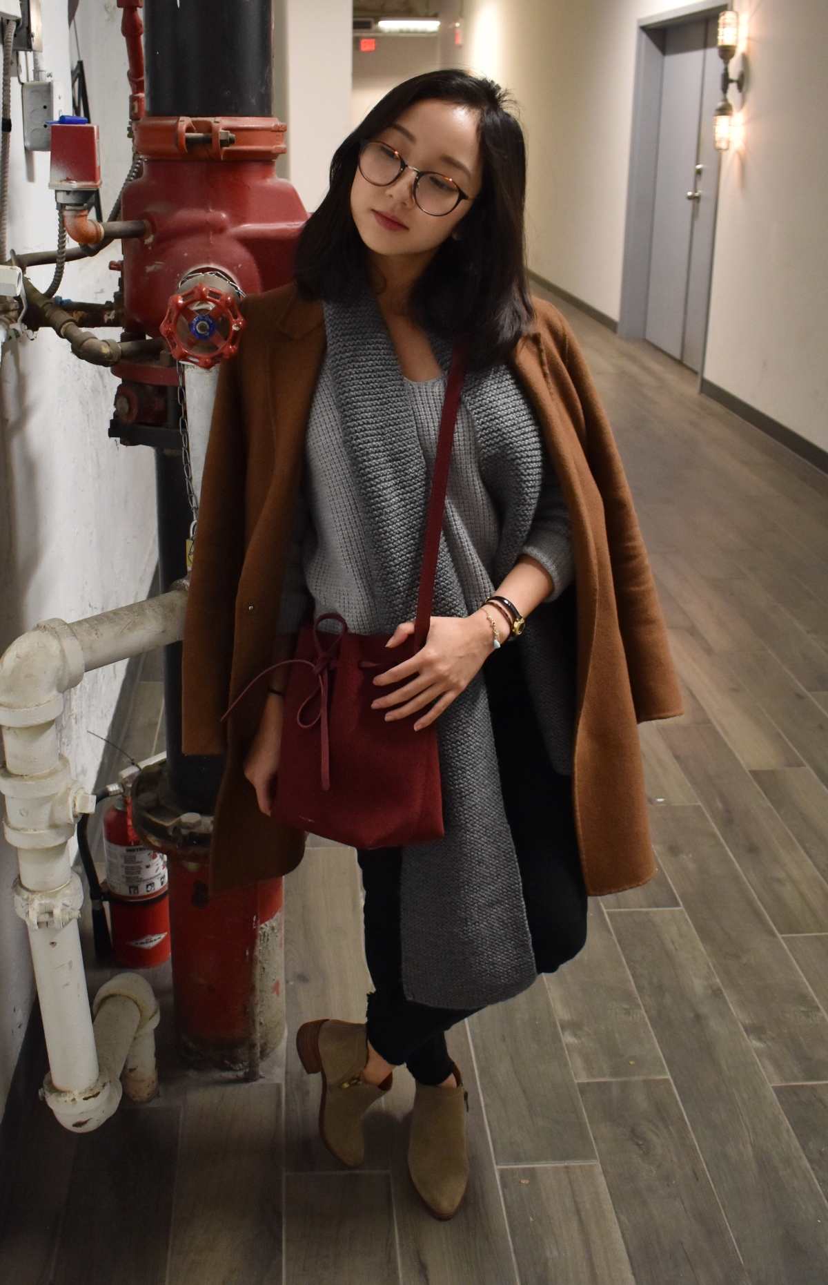 Simple fall ootd look featuring a brown zara wool coat, Wilfred wolter sweater, knitted scarf, Mansur Gavriel mini bucket bag in Rococo suede, Franco Sarto suede boots.